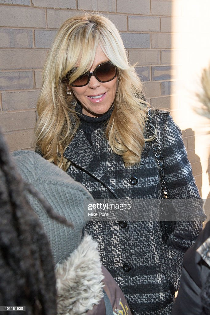 <a gi-track='captionPersonalityLinkClicked' href=/galleries/search?phrase=Dina+Lohan&family=editorial&specificpeople=594100 ng-click='$event.stopPropagation()'>Dina Lohan</a> (L) appears in court after her arrest on September 12, 2013 for Driving While Intoxicated and speeding at Nassau County First District Court on January 7, 2014 in Hempstead, New York.