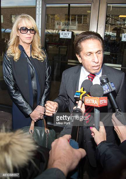 Dina Lohan appears in court with Attorney Mark Heller after her arrest on September 12 2013 for driving while intoxicated and speeding at Nassau...