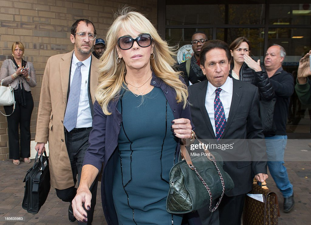 <a gi-track='captionPersonalityLinkClicked' href=/galleries/search?phrase=Dina+Lohan&family=editorial&specificpeople=594100 ng-click='$event.stopPropagation()'>Dina Lohan</a> (L) appears with Attorney Mark Heller at Nassau County First District Court after her arrest on September 12, 2013 on suspicion of driving while intoxicated after she was pulled over for speeding on Long Island, on October 23, 2013 in Hempstead, New York.