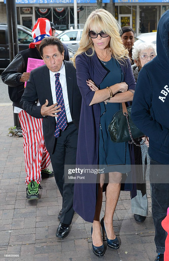 Dina Lohan (R) appears with Attorney Mark Heller at Nassau County First District Court after her arrest on September 12, 2013 on suspicion of driving while intoxicated after she was pulled over for speeding on Long Island, on October 23, 2013 in Hempstead, New York.