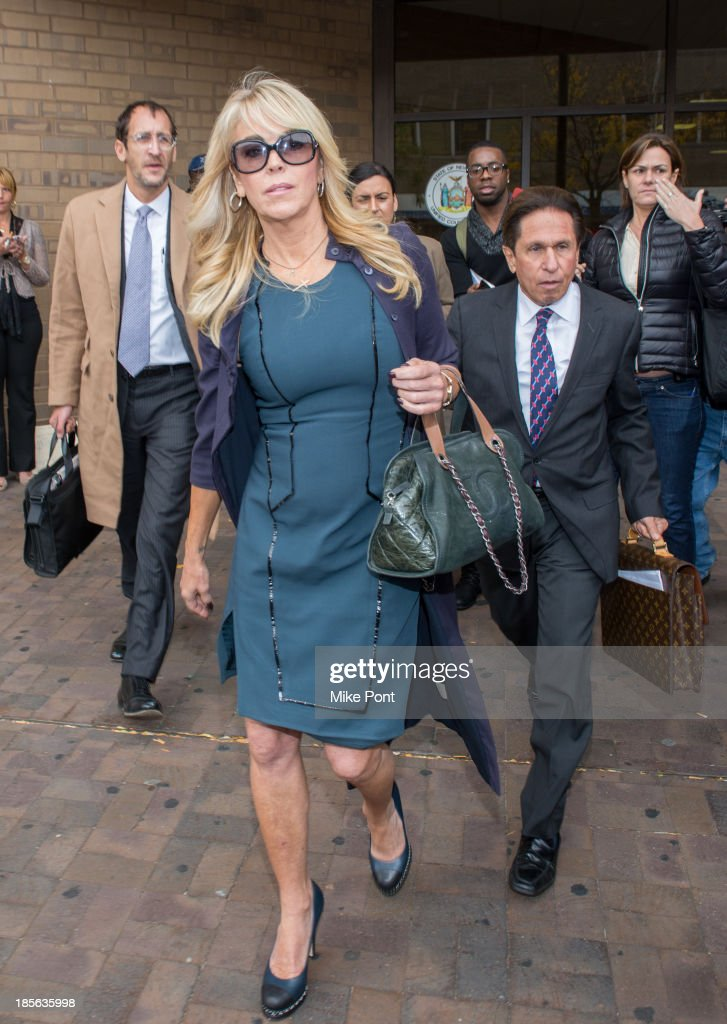 Dina Lohan (L) appears with Attorney Mark Heller at Nassau County First District Court after her arrest on September 12, 2013 on suspicion of driving while intoxicated after she was pulled over for speeding on Long Island, on October 23, 2013 in Hempstead, New York.