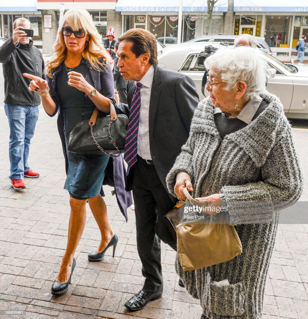 <a gi-track='captionPersonalityLinkClicked' href=/galleries/search?phrase=Dina+Lohan&family=editorial&specificpeople=594100 ng-click='$event.stopPropagation()'>Dina Lohan</a> (L) arrives with Attorney Mark Heller and her mother Ann Sullivan at Nassau County First District Court after her arrest on September 12, 2013 on suspicion of driving while intoxicated after she was pulled over for speeding on Long Island, on October 23, 2013 in Hempstead, New York.