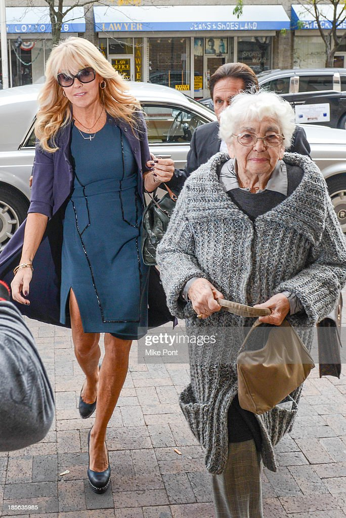 Dina Lohan (L) arrives with Attorney Mark Heller (obscured) and her mother Ann Sullivan (R) at Nassau County First District Court after her arrest on September 12, 2013 on suspicion of driving while intoxicated after she was pulled over for speeding on Long Island, on October 23, 2013 in Hempstead, New York.
