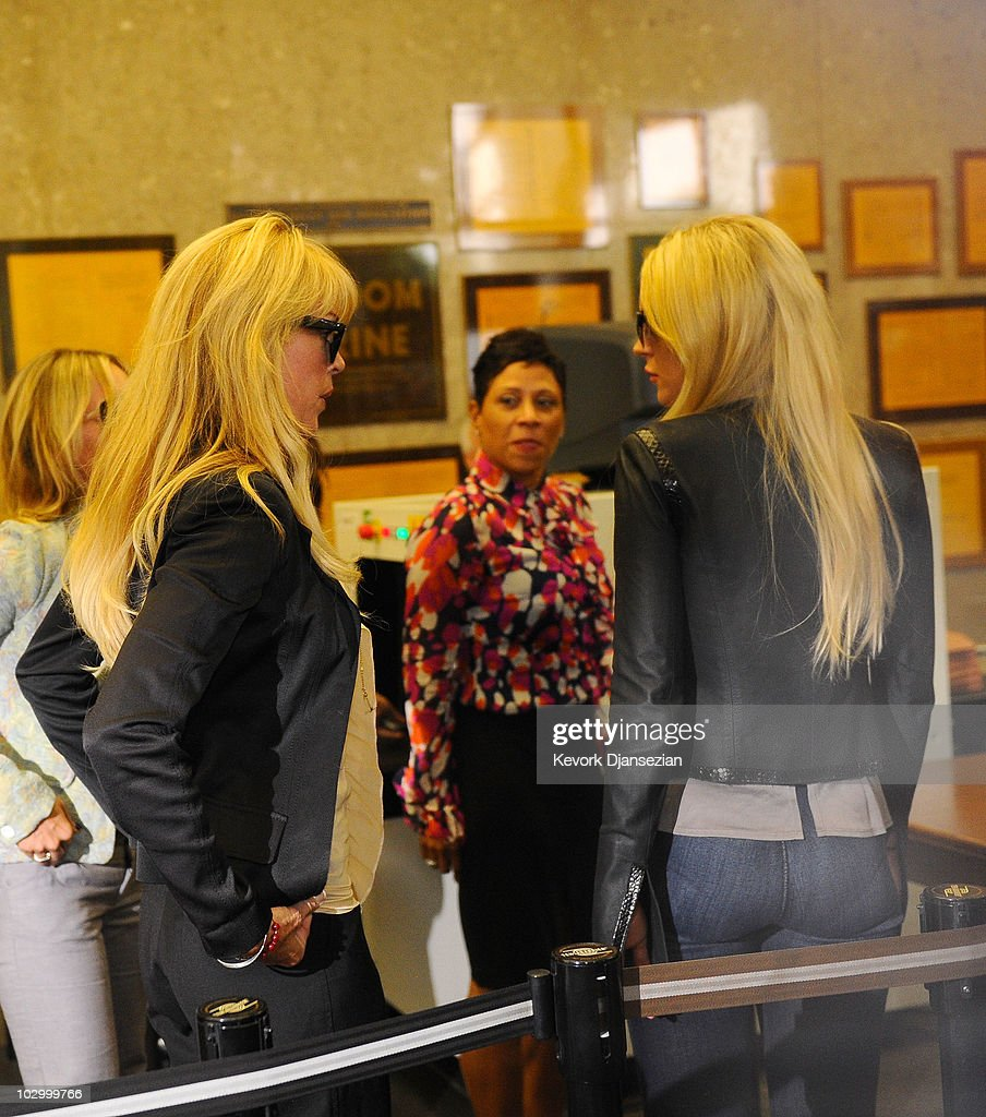 Dina Lohan lawyer Shawn Chapman Holley and actress Lindsay Lohan arrive at the Beverly Hills Courthouse on July 20 2010 in Beverly Hills California...