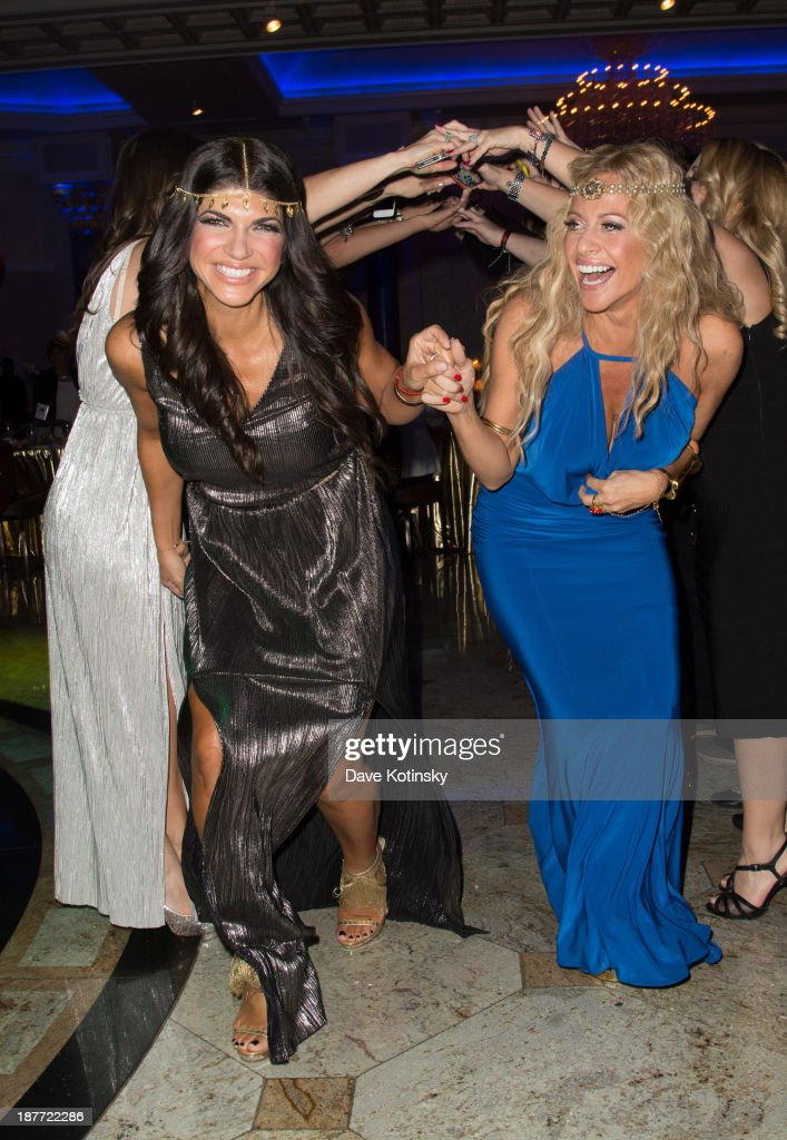 <a gi-track='captionPersonalityLinkClicked' href=/galleries/search?phrase=Dina+Manzo&family=editorial&specificpeople=5841104 ng-click='$event.stopPropagation()'>Dina Manzo</a> and <a gi-track='captionPersonalityLinkClicked' href=/galleries/search?phrase=Teresa+Giudice&family=editorial&specificpeople=5912953 ng-click='$event.stopPropagation()'>Teresa Giudice</a> attends the 'Goddess Night Out' event benefiting Project Lady Bug hosted by <a gi-track='captionPersonalityLinkClicked' href=/galleries/search?phrase=Dina+Manzo&family=editorial&specificpeople=5841104 ng-click='$event.stopPropagation()'>Dina Manzo</a> on November 11, 2013 in Garfield, New Jersey.