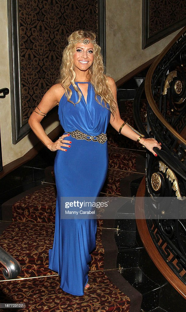 <a gi-track='captionPersonalityLinkClicked' href=/galleries/search?phrase=Dina+Manzo&family=editorial&specificpeople=5841104 ng-click='$event.stopPropagation()'>Dina Manzo</a> attends the 'Goddess Night Out' event benefiting Project Lady Bug hosted by <a gi-track='captionPersonalityLinkClicked' href=/galleries/search?phrase=Dina+Manzo&family=editorial&specificpeople=5841104 ng-click='$event.stopPropagation()'>Dina Manzo</a> on November 11, 2013 in Garfield, New Jersey.