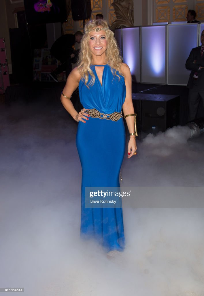 <a gi-track='captionPersonalityLinkClicked' href=/galleries/search?phrase=Dina+Manzo&family=editorial&specificpeople=5841104 ng-click='$event.stopPropagation()'>Dina Manzo</a> osts attends the 'Goddess Night Out' event benefiting Project Lady Bug hosted by <a gi-track='captionPersonalityLinkClicked' href=/galleries/search?phrase=Dina+Manzo&family=editorial&specificpeople=5841104 ng-click='$event.stopPropagation()'>Dina Manzo</a> on November 11, 2013 in Garfield, New Jersey.
