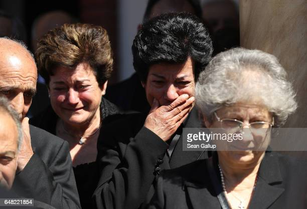 Dina Mita and Androula Savva weep at the Orthodox funeral service for their brother Georgiou Theodoulos Theodoulou as his coffin arrives on March 5...