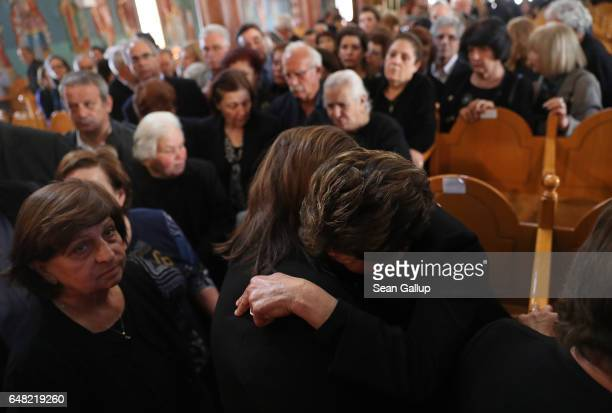 Dina Mita is embraced by a mourner at the funeral service for Mita's brother Georgiou Theodoulos Theodoulou on March 5 2017 in Pera Chorio Nisou...