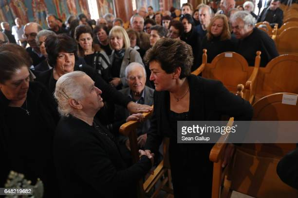 Dina Mita recieves condolences from mourners at the funeral service for Mita's brother Georgiou Theodoulos Theodoulou on March 5 2017 in Pera Chorio...