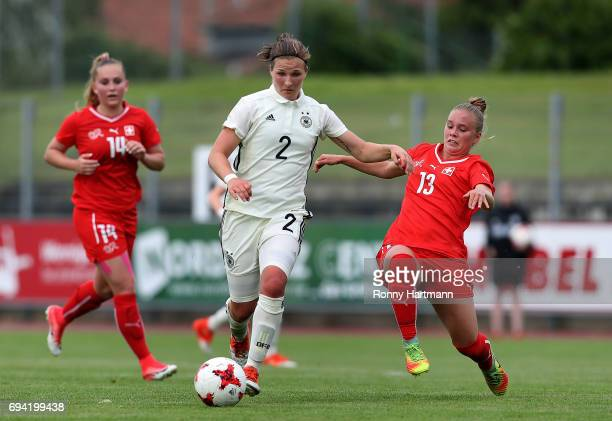 Dina Orschmann of Germany competes with Celine von Potobsky and Alicia Haller of Switzerland during the U19 women's elite round match between Germany...