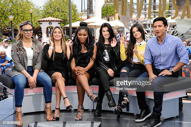 Dinah Jane Hansen Ally Brooke Normani Kordei Lauren Jauregui and Camila Cabello of Fifth Harmony and Mario Lopez visit 'Extra' at Universal Studios...