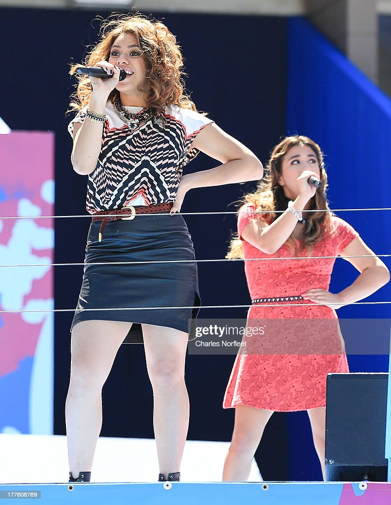 <a gi-track='captionPersonalityLinkClicked' href=/galleries/search?phrase=Dinah+Jane+Hansen&family=editorial&specificpeople=9951841 ng-click='$event.stopPropagation()'>Dinah Jane Hansen</a> (L) and <a gi-track='captionPersonalityLinkClicked' href=/galleries/search?phrase=Ally+Brooke&family=editorial&specificpeople=9748330 ng-click='$event.stopPropagation()'>Ally Brooke</a> Hernandez of Fifth Harmony perform during the 2013 Arthur Ashe Kids Day at USTA Billie Jean King National Tennis Center on August 24, 2013 in the Queens borough of New York City.