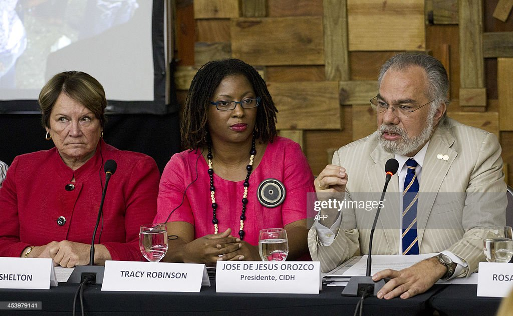 Dinah Shelton (L), Tracy Robinson (C), first vice president and Jose de Jesus Orozco, president of the Inter American Commission of Human Rights (IACHR), give in a press conference in Santo Domingo, on December 6, 2013. The IACHR visit comes after the Constitutional Court of the Dominican Republic on September stripped from their citizenship more than 250,000 Dominican-born offspring of undocumented Haitians. AFP PHOTO / Erika SANTELICES