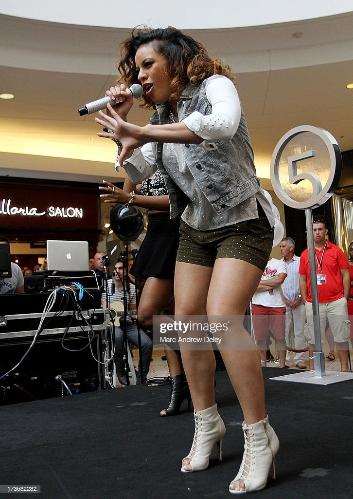 Dinah-Jane Hansen of <a gi-track='captionPersonalityLinkClicked' href=/galleries/search?phrase=Fifth+Harmony&family=editorial&specificpeople=9960104 ng-click='$event.stopPropagation()'>Fifth Harmony</a> performs at the Square One Mall on July 15, 2013 in Saugus, Massachusetts.