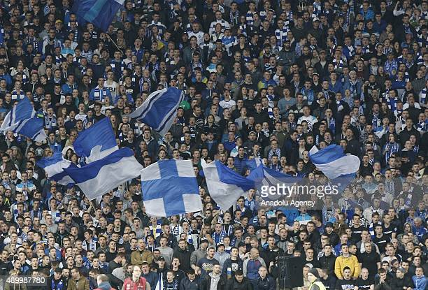 Dinamo Kiev's fans support their team during the UEFA Europa League quarter final match between Dinamo Kiev and Fiorentina at Nsk Olimpijskyj in Kiev...