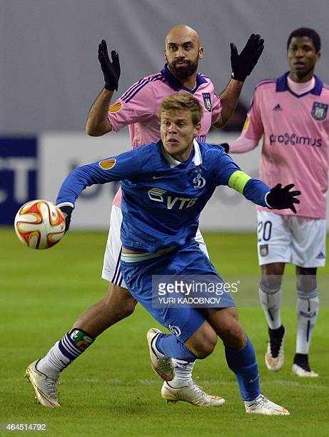 Dinamo Moscow's forward Alexander Kokorin vies for the ball with Anderlecht's defender Anthony Vanden Borre during the UEFA Europa League round of 32...