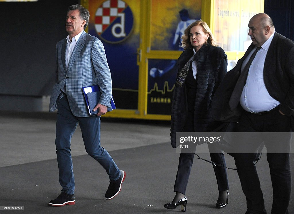 Dinamo Zagreb football chief Zdravko Mamic (L) arrives with his lawyers Jadranka Slokovic (C) and Cedo Prodanovic to a press conference where he announced his resignation at the club's headquarters, in Zagreb, on February 9, 2016. Dinamo Zagreb chief Zdravko Mamic resigned on February 9, 2016 a day after Croatian national anti-graft prosecutors opened another multi-million-euro probe against him. On February 8, the national anti-graft USKOK bureau said it was probing Mamic and six other people including his brother Zoran, who is Dinamo coach, son Mario and former director Damir Vrbanovic. They are alleged to have embezzled nearly 70 million kunas (nine million euros, $10.3 million) of Dinamo Zagreb's money through fictitious deals related to player transfers. / AFP / STR