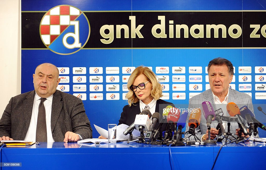 Dinamo Zagreb football chief Zdravko Mamic (R) sits with his lawyer Jadranka Slokovic (C) and Cedo Prodanovic(L) as he holds a press conference where he announced his resignation at the club's headquarters, in Zagreb, on February 9, 2016. Dinamo Zagreb chief Zdravko Mamic resigned on February 9, 2016 a day after Croatian national anti-graft prosecutors opened another multi-million-euro probe against him. On February 8, the national anti-graft USKOK bureau said it was probing Mamic and six other people including his brother Zoran, who is Dinamo coach, son Mario and former director Damir Vrbanovic. They are alleged to have embezzled nearly 70 million kunas (nine million euros, $10.3 million) of Dinamo Zagreb's money through fictitious deals related to player transfers. / AFP / STR