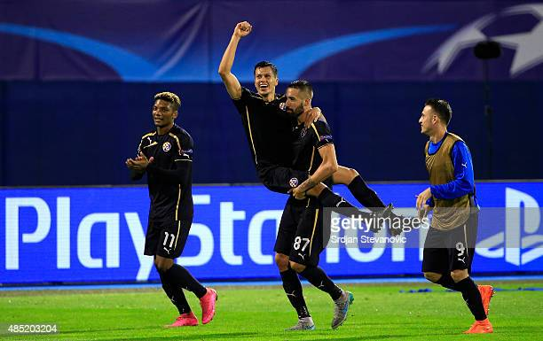 Dinamo Zagreb players Junior Fernandes Leonardo Sigali Jeremy Taravel and Angelo Henriquez celebrate victory after the UEFA Champions League...