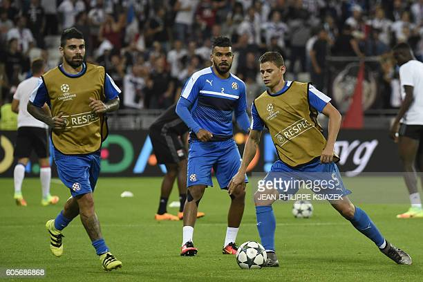 Dinamo Zagreb's Algerian forward El Arabi Hilal Soudani and teammates warmup ahead of the UEFA Champions League Group H football match between Lyon...