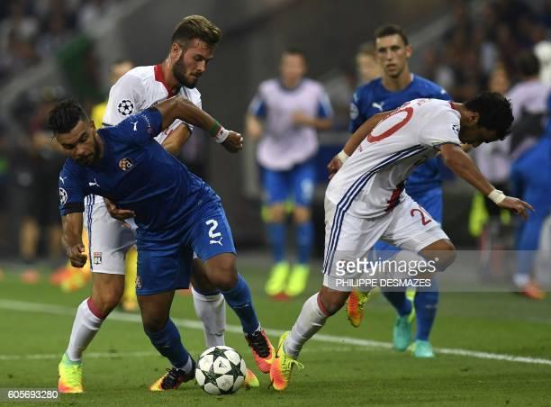 Dinamo Zagreb's Algerian forward El Arabi Hilal Soudani vies with Lyon's Brazilian defender Rafael Da Silva during the Champions League Group H...