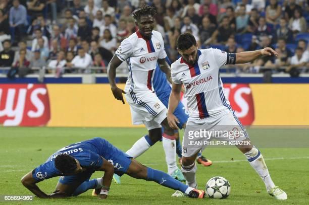 Dinamo Zagreb's Algerian forward El Arabi Hilal Soudani vies with Lyon's French midfielder Jordan Ferri during the Champions League Group H football...