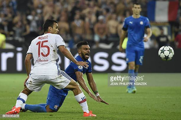 Dinamo Zagreb's Algerian forward El Arabi Hilal Soudani vies with Lyon's French defender Jeremy Morel during the Champions League Group H football...