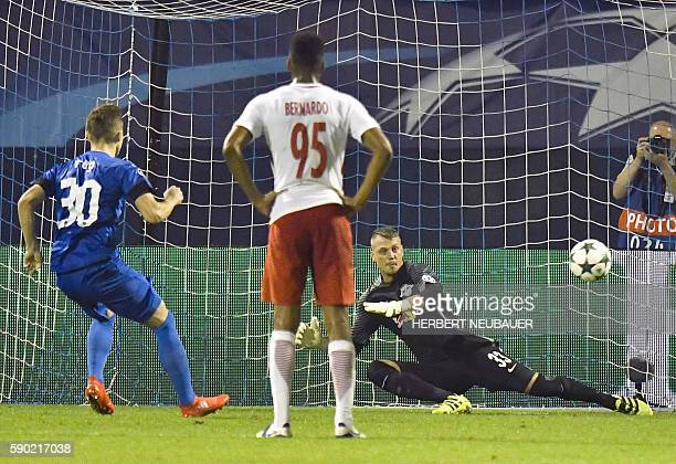 Dinamo Zagreb's Marko Rog scores with a penalty shot against Red Bull Salzburg's goalkeeper Alexander Walke during the UEFA Champions league first...