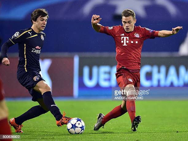 Dinamo Zagreb's midfielder Ante Coric vies with Bayern Munich's midfielder Joshua Kimmich during the UEFA Champions League football match between...