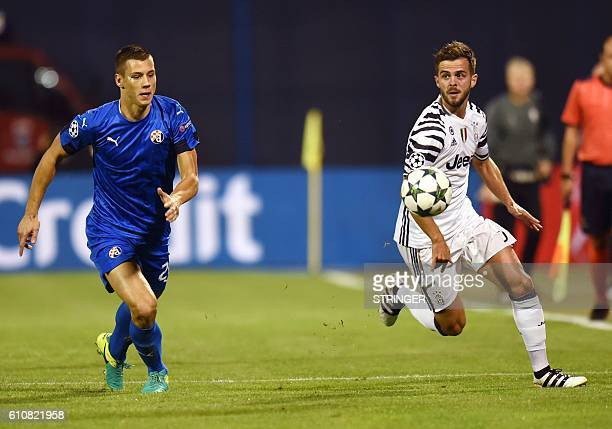 Dinamo's defender Filip Benkovic vies with Juventus' midfielder Miralem Pjanic during the UEFA Champions League football match between GNK Dinamo...