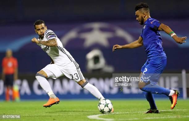 Dinamo's El Arabi Hilal Soudani vies with Juventus Dani Alves during their UEFA Champions League football match between GNK Dinamo Zagreb and...