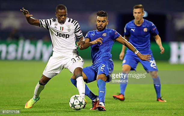 Dinamo's El Arabi Hilal Soudani vies with Juventus' Patrice Evra during their UEFA Champions League football match between GNK Dinamo Zagreb and...