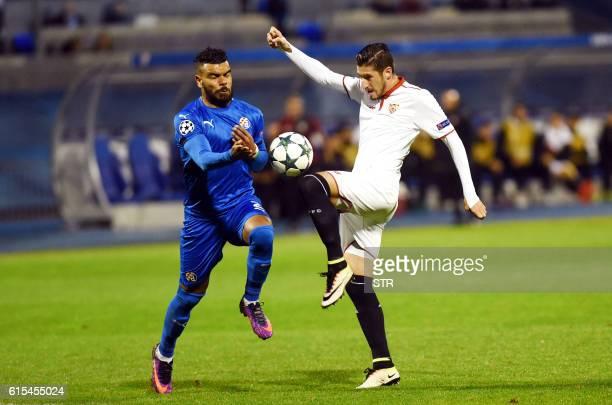 Dinamo's forward Hilal Soudani vies with Sevilla's midfielder Sergio Escudero during the UEFA Champions League football match between GNK Dinamo...