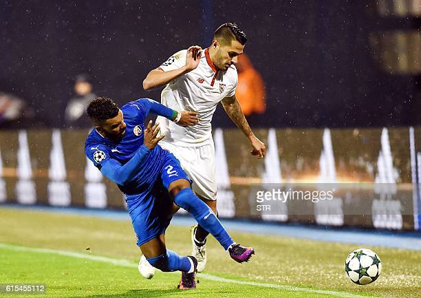 Dinamo's forward Hilal Soudani vies with Sevilla's midfielder Vitolo during the UEFA Champions League football match between GNK Dinamo Zagreb and...