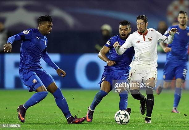 Dinamo's forward Junior Fernandes and El Arabi Hilal Soudani vies with Sevilla's Sergio Escudero during the UEFA Champions League football match...