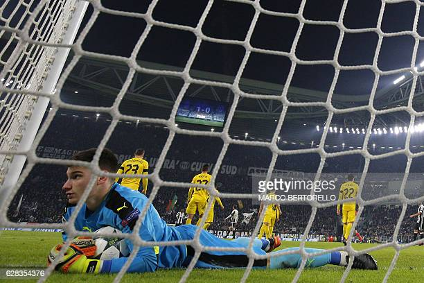 Dinamo's goalkeeper Dominik Livakovic of Croatia reacts after he fails to stop a goal during the UEFA Champions League football match Juventus Vs GNK...