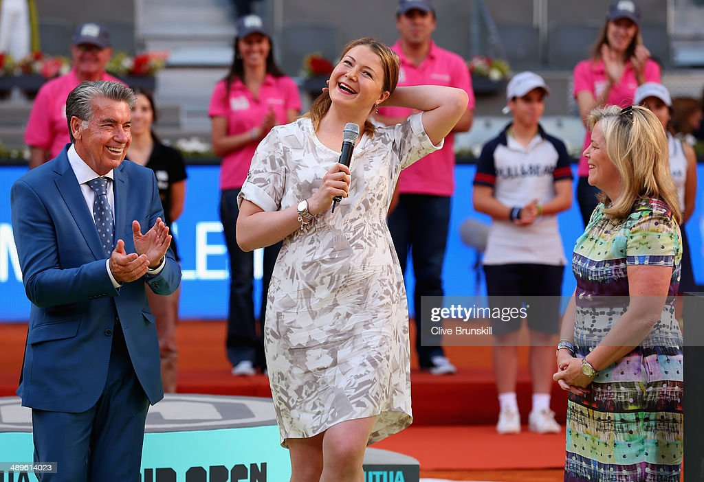 Dinara Safina of Russia makes a speach to the crowd announcing her retirement watched by Stacey Allaster CEO of the WTA Tour and Manolo Santana...