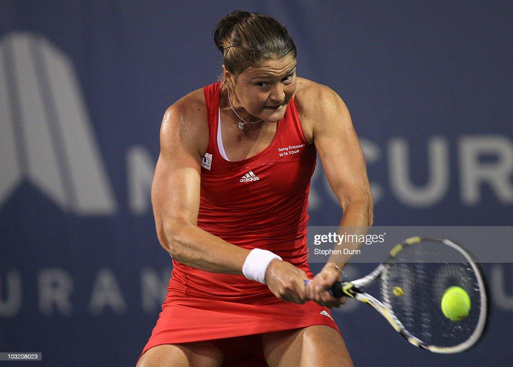 Dinara Safina of Russia returns to Alona Bondarenko of the Ukraine during their match in the Mercury Insurance Open at La Costa Resort and Spa in...