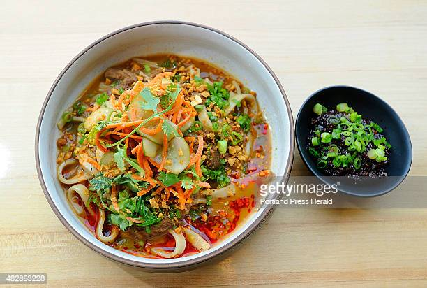 Dine Out Maine art from Honey Paw Udon Noodle includes smoked cumin lamb black vinegar curry peanut cucumber with a special spicy chili sauce to...