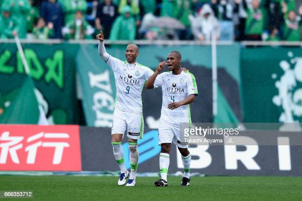 Dinei of Shonan Bellmare celebrates scoring his side's second goal with his team mate Andre Bahia during the JLeague J2 match between Tokyo Verdy and...