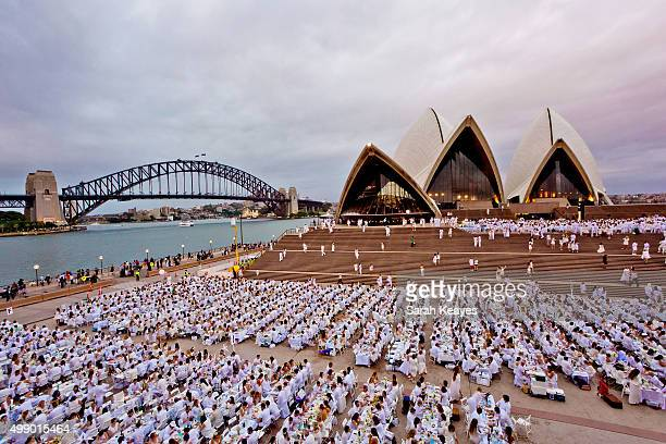 Diner en Blanc at Sydney Opera House on November 28 2015 in Sydney Australia Diner en Blanc is a popup picnic that started in Paris over 20 years ago...