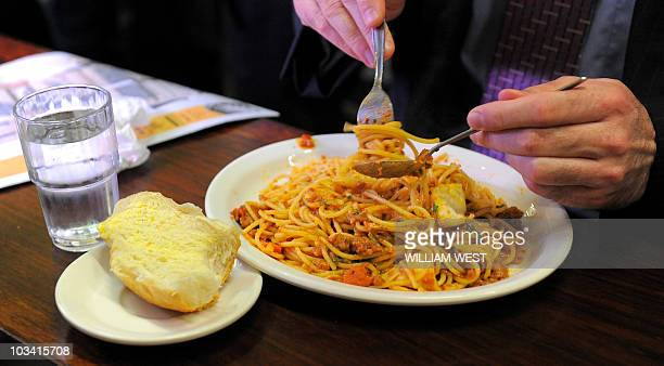 A diner twirls his spaghetti at Pellegrini's Expresso Bar in Melbourne on April 14 2010 Opened in 1954 Pellegrini's is a Melbourne favourite with...