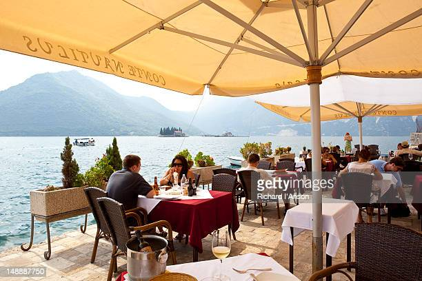 Diners at Conte Nautilus restaurant's waterside terrace.