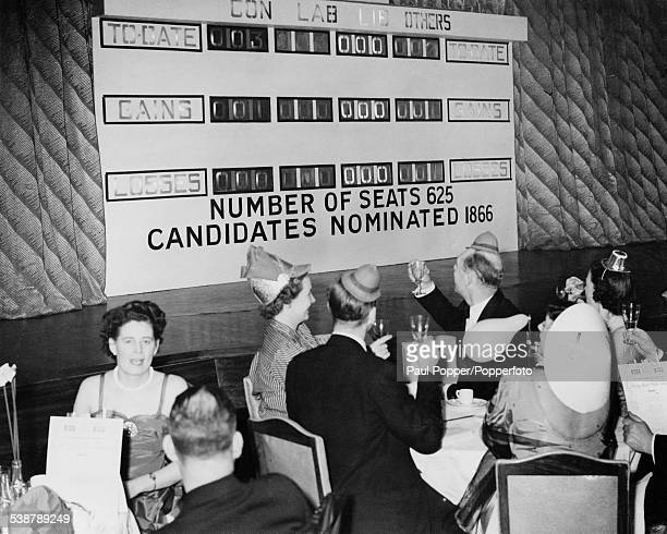 Diners at the Trocadero Restaurant in London party into the night under a scoreboard which shows the latest results of the General Election 24th...