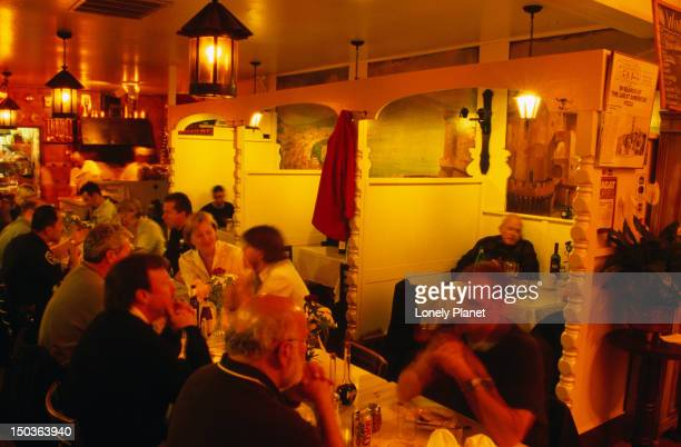 Diners at Tomasso's, a popular pizzeria at North Beach.