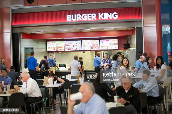 Diners eat lunch at a food court in a downtown office building on September 15 2015 in Chicago Illinois Sales at retail stores and restaurants...