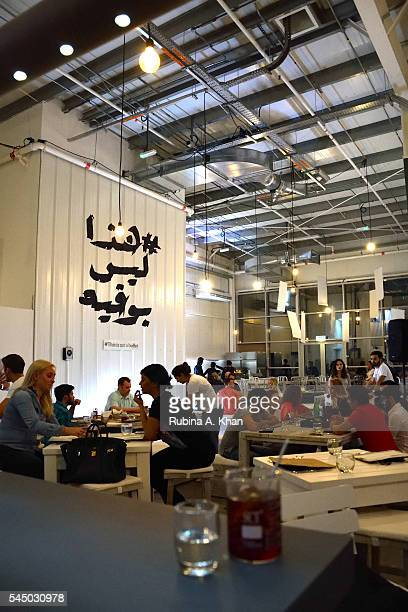 Diners enjoying contemporary Arabic cuisine at the Ramadan iftar popup at Alserkal Avenue catered by Elements Catering on July 4 2016 in Dubai United...