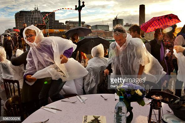 Diners in the rain arrive at the Forgotten Fish restaurant prepared for the evening a special meal prepared by chef Thomas Hunt in collaboration with...