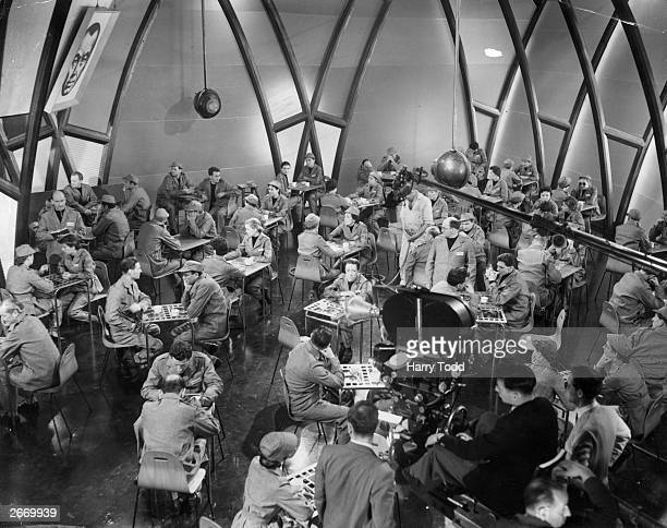 Diners in the statecontrolled restaurant during the filming of George Orwell's novel '1984' directed by Michael Anderson at Elstree Studios